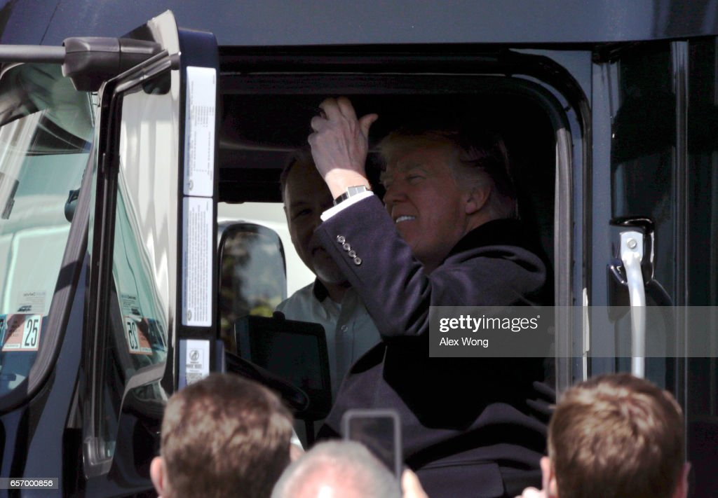 U.S. President Donald Trump sits in the cab of a truck and pulls the horn as he welcomes members of American Trucking Associations to the White House March 23, 2017 in Washington, DC. President Trump hosted truckers and CEOs for a listening session on healthcare.