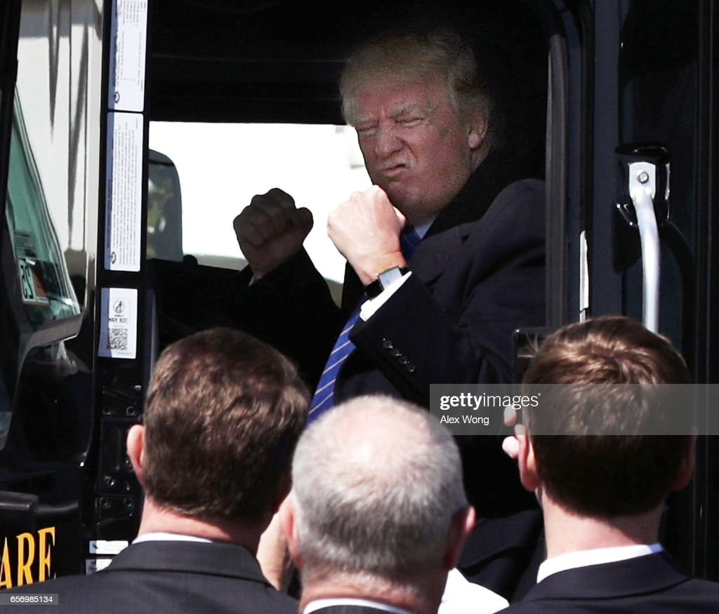 U.S. President Donald Trump sits in the cab of a truck as he welcomes members of American Trucking Associations to the White House March 23, 2017 in Washington, DC. President Trump hosted truckers and CEOs for a listening session on healthcare.