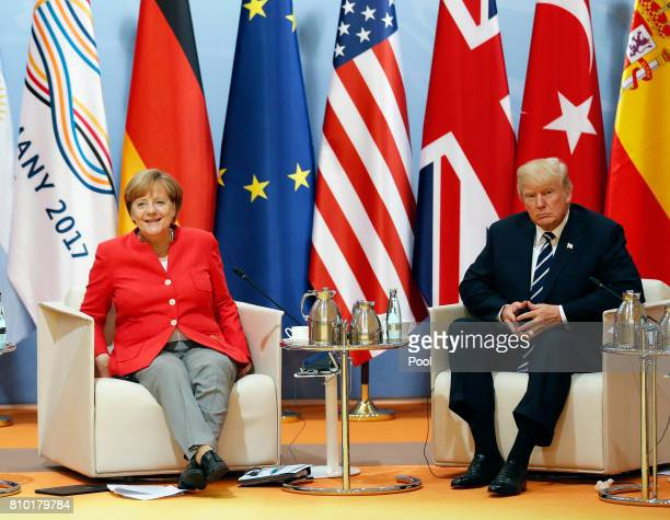 President Donald Trump sits next to German Chancellor Angela Merkel during the G20 leaders retreat as part of the G20 summit on July 7 2017 in...