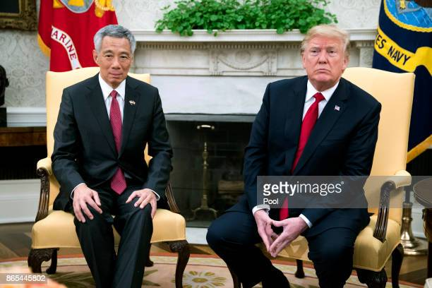 US President Donald Trump sits with Prime Minister Lee Hsien Loong of Singapore in the Oval Office before a series of meetings between the two at the...