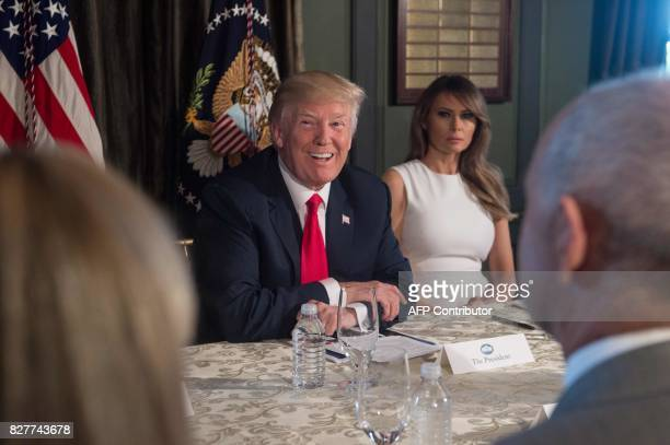 US President Donald Trump smiles before a meeting with administration officials and First Lady Melania Trump on the opioid addiction crisis at the...