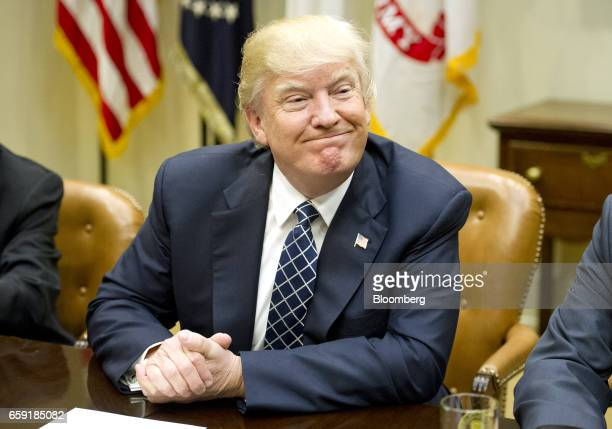 US President Donald Trump smiles during a listening session with the Fraternal Order of Police in the Roosevelt Room of the White House in Washington...