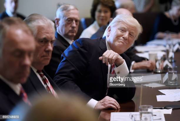 US President Donald Trump smiles during a meeting with Cabinet members at the White House in Washington DC US on Monday June 12 2017 US Attorney...