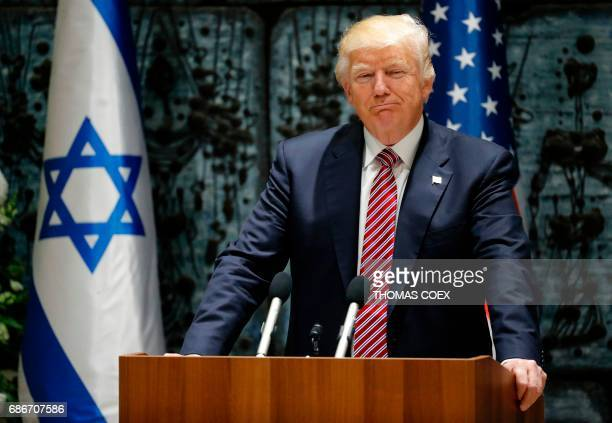 US President Donald Trump smiles during a press conference at the President's Residence in Jerusalem on May 22 2017 / AFP PHOTO / Thomas COEX