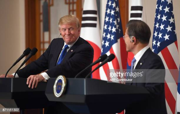 US President Donald Trump smiles with South Korean President Moon JaeIn during a joint press conference at the presidential Blue House in Seoul on...