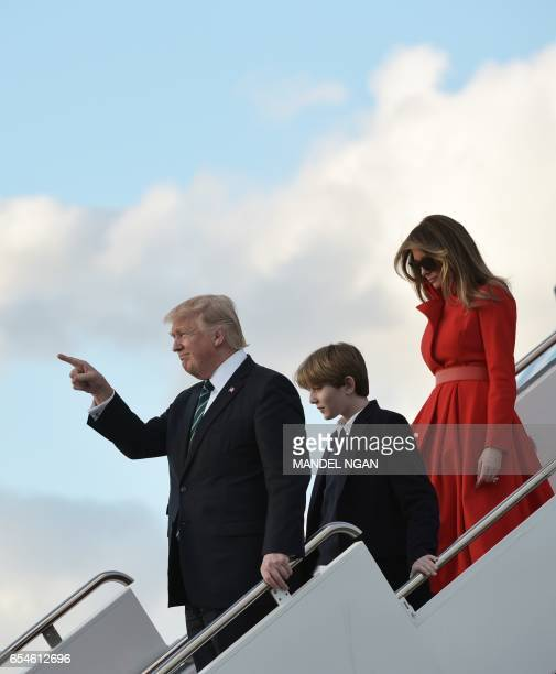 US President Donald Trump son Barron and wife Melania step off Air Force One upon arrival at Palm Beach International Airport in West Palm Beach...