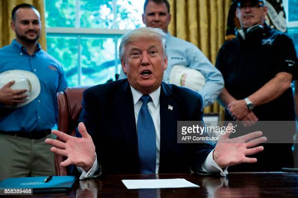 President Donald Trump speaks about business during a proclamation signing in the Oval Office of the White House October 6 2017 in Washington DC /...