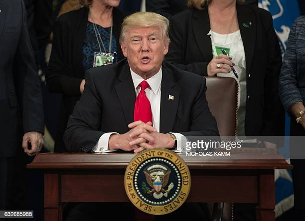US President Donald Trump speaks after signing an executive order to start the Mexico border wall project at the Department of Homeland Security...