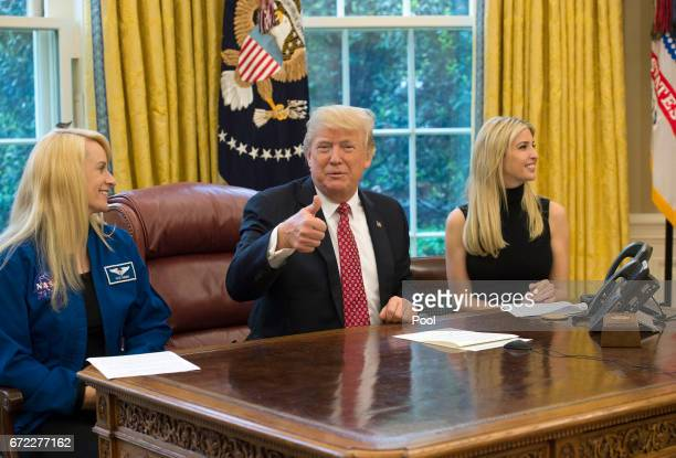 US President Donald Trump speaks along with his daughter Ivanka Trump and NASA Astronaut Kate Rubins during a video conference with NASA astronauts...