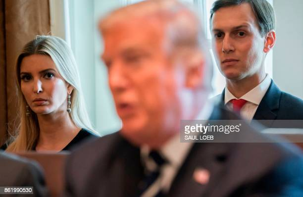 US President Donald Trump speaks alongside his daughter Ivanka Trump and her husband Senior White House Adviser Jared Kushner during a Cabinet...