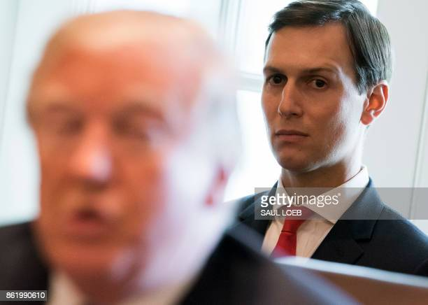 US President Donald Trump speaks alongside his Senior White House Adviser Jared Kushner during a Cabinet Meeting in the Cabinet Room of the White...