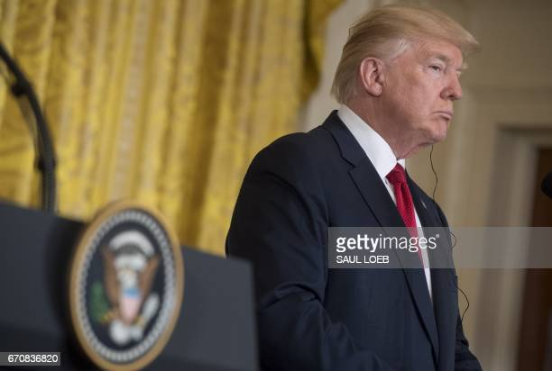 US President Donald Trump speaks alongside Italian Prime Minister Paolo Gentiloni during a press conference in the East Room at the White House in...