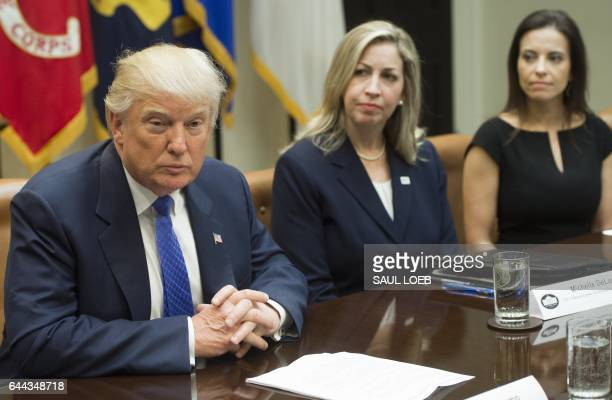 US President Donald Trump speaks alongside Michelle DeLaune of the National Center for Missing and Exploited Children and Dina Powell White House...
