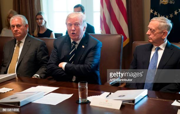 US President Donald Trump speaks alongside Secretary of State Rex Tillerson and Secretary of Defense James Mattis during a Cabinet Meeting in the...