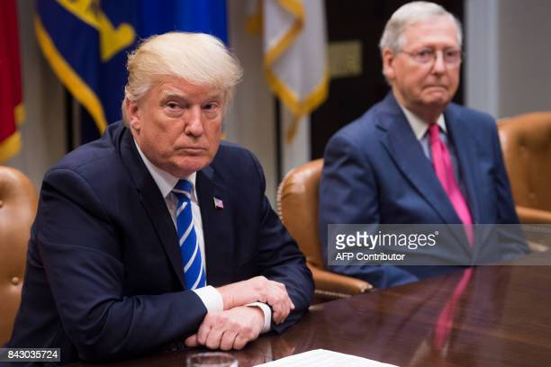 US President Donald Trump speaks alongside Senate Majority Leader Mitch McConnell as they hold a meeting about tax reform in the Roosevelt Room of...
