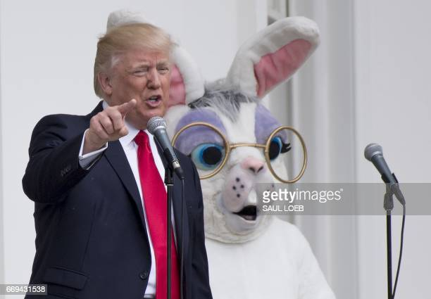US President Donald Trump speaks alongside the Easter Bunny during the 139th White House Easter Egg Roll on the South Lawn of the White House in...