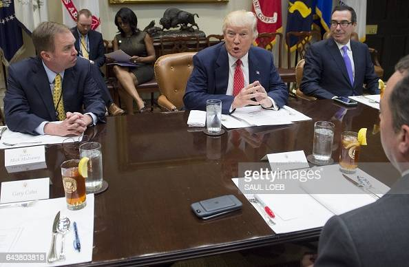 US President Donald Trump speaks alongside Treasury Secretary Steven Mnuchin and Office of Management and Budget Director Mick Mulvaney during a...