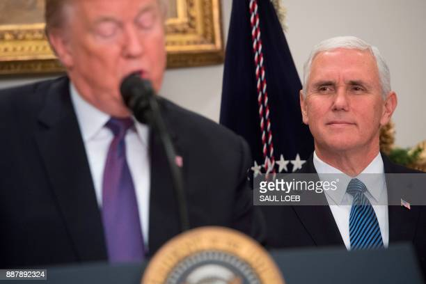 US President Donald Trump speaks alongside US Vice President Mike Pence during an event marking National Pearl Harbor Remembrance Day in the...