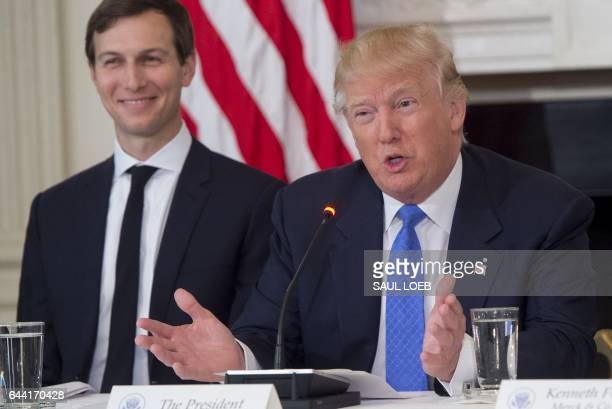 US President Donald Trump speaks alongside White House Senior Advisor Jared Kushner during a meeting with manufacturing CEOs in the State Dining Room...