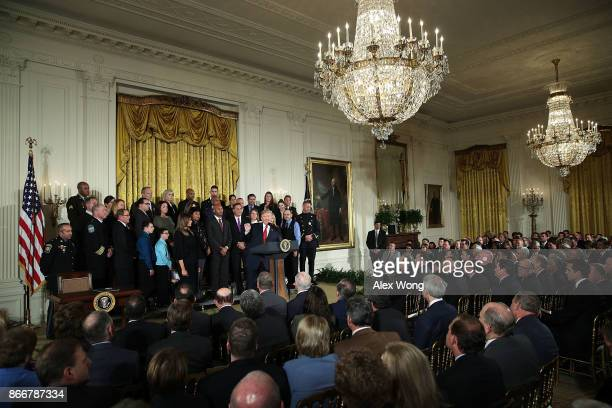 S President Donald Trump speaks as first lady Melania Trump and other attendees look on during an event highlighting the opioid crisis in the US...