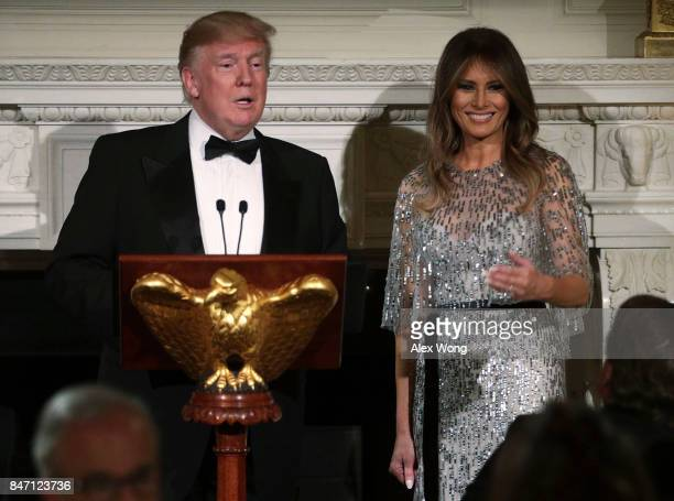 S President Donald Trump speaks as first lady Melania Trump listens during a reception at the State Dining Room of the White House September 14 2017...