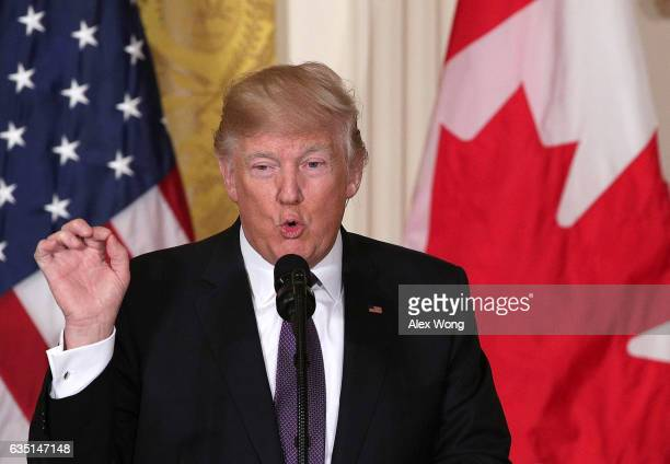 S President Donald Trump speaks as he participates in a joint news conference with Canadian Prime Minister Justin Trudeau in the East Room of the...