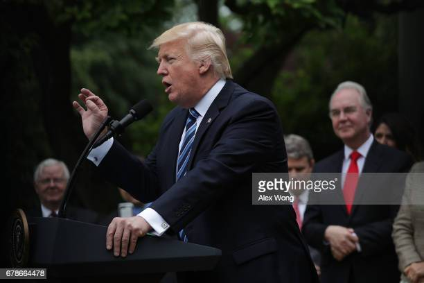 S President Donald Trump speaks as Health and Human Services Secretary Tom Price looks on during a Rose Garden event May 4 2017 at the White House in...