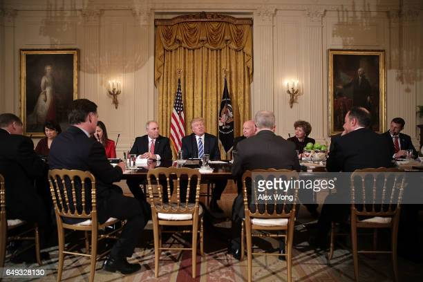 S President Donald Trump speaks as House Majority Whip Rep Steve Scalise Rep Kevin Brady and other House members listen during a meeting with the...