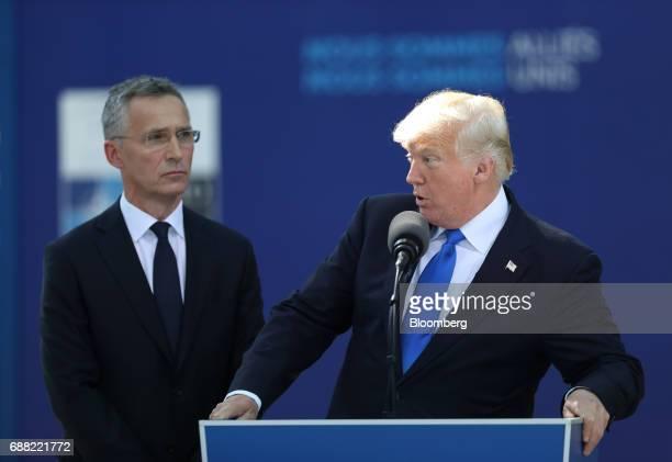 US President Donald Trump speaks as Jens Stoltenberg secretary general of the North Atlantic Treaty Organization looks on during a summit of world...