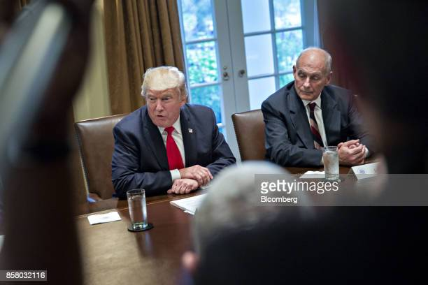 US President Donald Trump speaks as John Kelly White House chief of staff right listens during a briefing with senior military leaders in the Cabinet...
