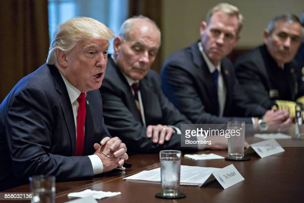 US President Donald Trump speaks as John Kelly White House chief of staff second left listens during a briefing with senior military leaders in the...