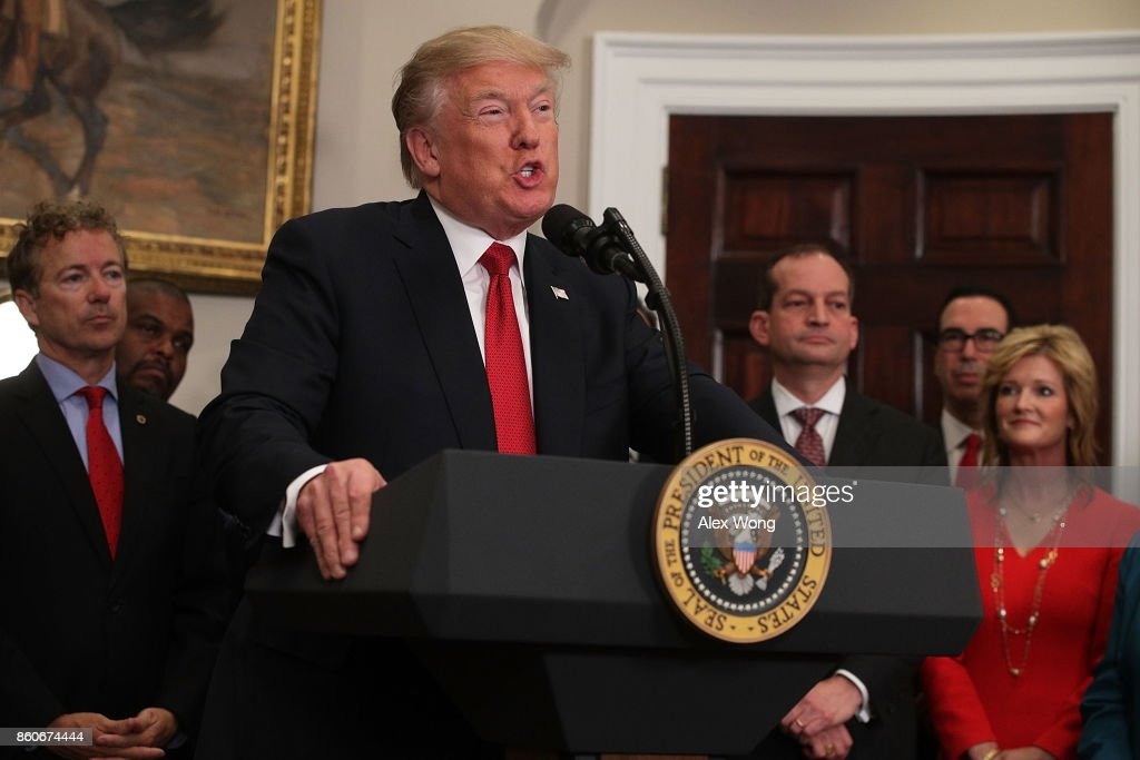 U.S. President Donald Trump speaks as Sen. Rand Paul (R-KY) (L), Secretary of Labor Alexander Acosta (3rd R) and Secretary of the Treasury Steven Mnuchin (2nd R) look on during an event in the Roosevelt Room of the White House October 12, 2017 in Washington, DC. President Trump signed the executive order to loosen restrictions on Affordable Care Act 'to promote healthcare choice and competition.'