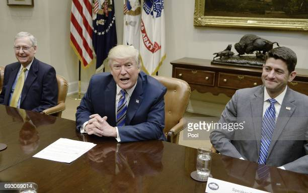 President Donald Trump speaks as Senate Majority Leader Mitch McConnell and House Speaker Paul Ryan listen during a meeting with House and Senate...