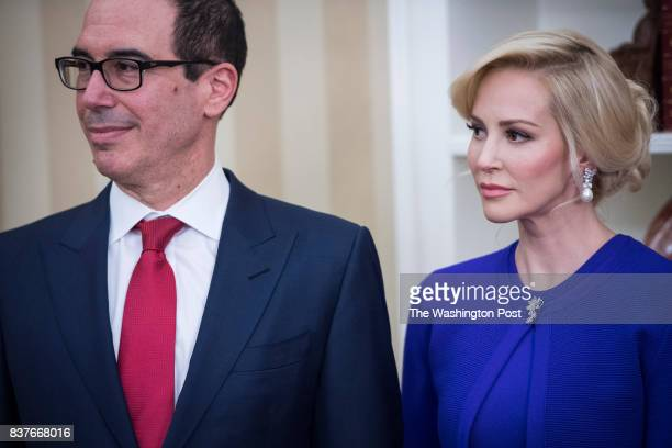 President Donald Trump speaks as Steven Mnuchin his fiancee Louise Linton and Vice President Mike Pence participate in a ceremonial swearing in for...