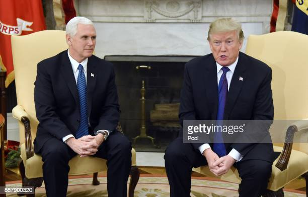 US President Donald Trump speaks as Vice President Mike Pence looks on during a meeting with Congressional leadership including House Minority Leader...