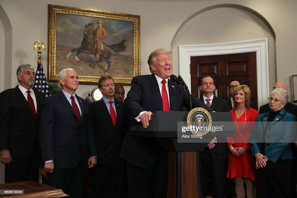 U.S. President Donald Trump speaks as Vice President Mike Pence (2nd L), Sen. Rand Paul (R-KY) (3rd L), Secretary of Labor Alexander Acosta (3rd R) and Rep. Virginia Foxx (R-NC) (R) look on during an event in the Roosevelt Room of the White House October 12, 2017 in Washington, DC. President Trump signed the executive order to loosen restrictions on Affordable Care Act 'to promote healthcare choice and competition.'