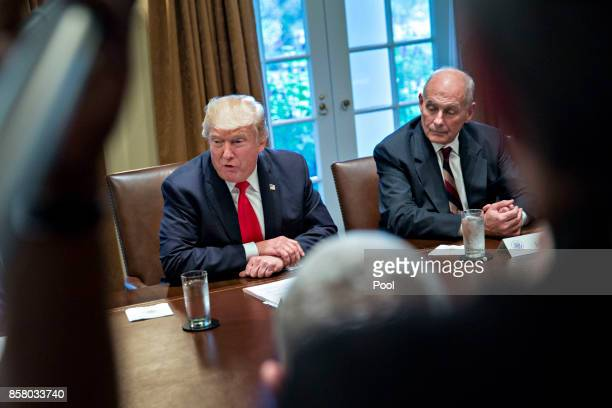 S President Donald Trump speaks as White House chief of staff John Kelly at a briefing with senior military leaders in the Cabinet Room of the White...