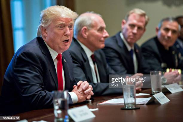 S President Donald Trump speaks at a briefing with senior military leaders in the Cabinet Room of the White House October 5 2017 in Washington DC...