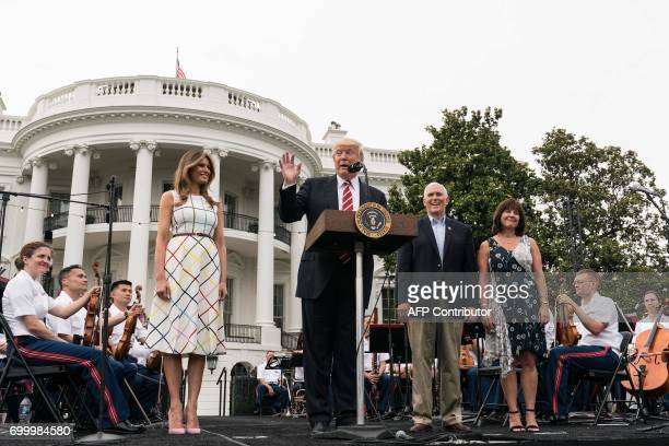 US President Donald Trump speaks at the Congressional picnic with US First Lady Melania Trump Vice President Mike Pence and his wife Karen at the...