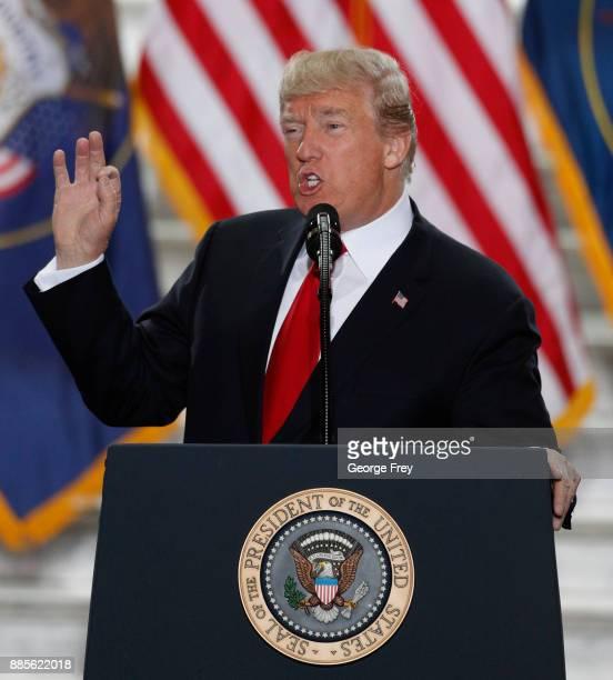S President Donald Trump speaks at the Rotunda of the Utah State Capitol on December 4 2017 in Salt Lake City Utah Trump announced the reduction in...