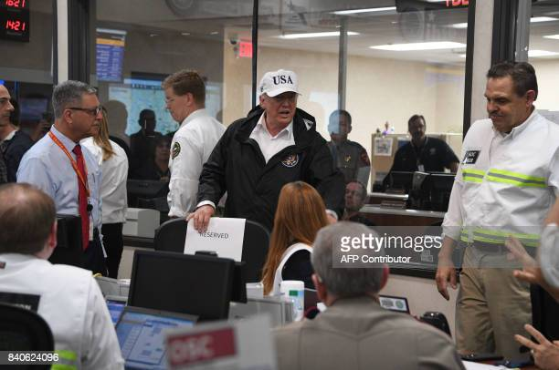US President Donald Trump speaks at the Texas Department of Public Safety Emergency Operations Center in Austin Texas on August 29 as rains from...