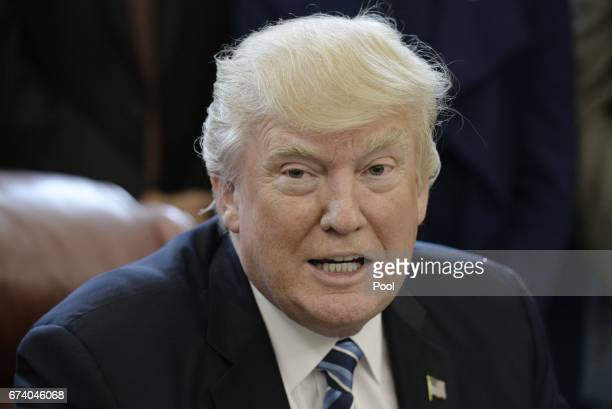 US President Donald Trump speaks before signing a Memorandum on Aluminum Imports and Threats to National Security in the Oval Office on April 27 2017...