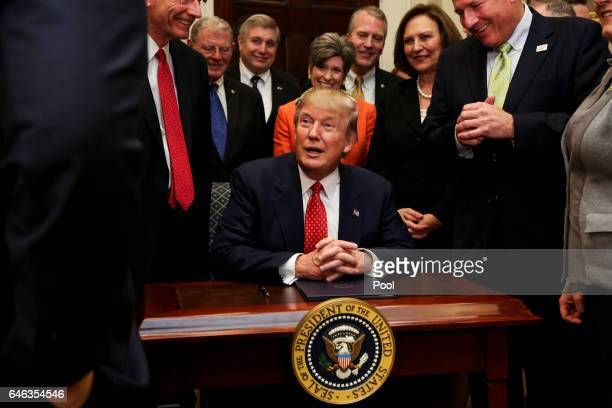 President Donald Trump speaks before signing an Executive Order to begin the rollback of environmental regulations put in place by the Obama...