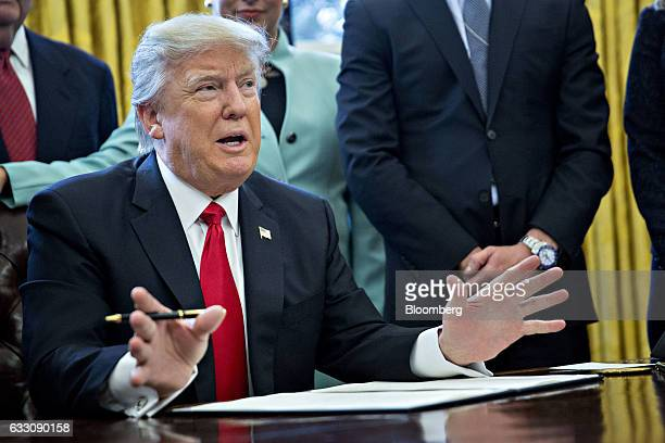 US President Donald Trump speaks before signing an executive order while surrounded by small business leaders in the Oval Office of the White House...