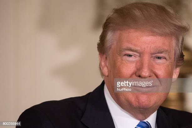 President Donald Trump speaks beofre signing the Department of Veterans Affairs Accountability and Whistleblower Protection Act of 2017 in the East...