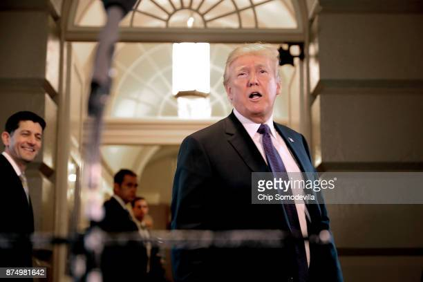 S President Donald Trump speaks briefly to journalists after leaving a House Republican conference meeting at the US Capitol November 16 2017 in...