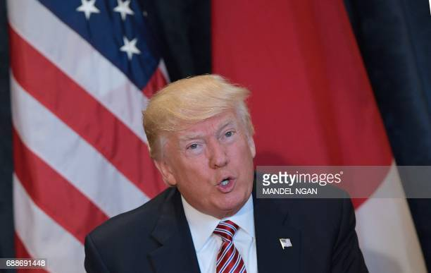 US President Donald Trump speaks during a bilateral meeting with Japan's Prime Minister Shinzo Abe on the sidelines of the G7 Summit in Taormina...