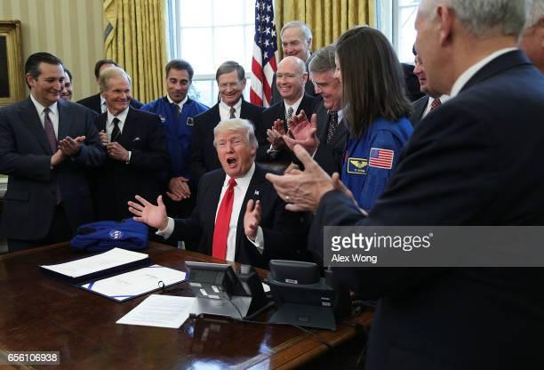 S President Donald Trump speaks during a bill signing ceremony as legislators including Sen Ted Cruz Sen Bill Nelson and Rep John Culberson look on...