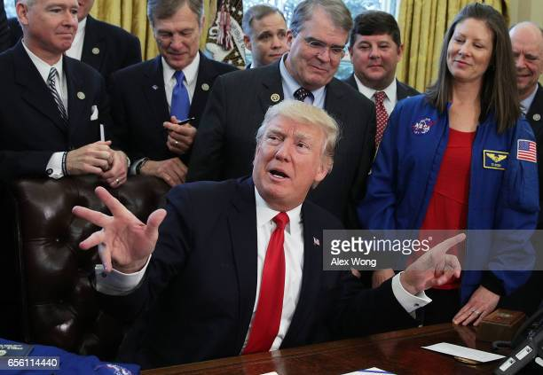 S President Donald Trump speaks during a bill signing ceremony in the Oval Office of the White House March 21 2017 in Washington DC President Trump...