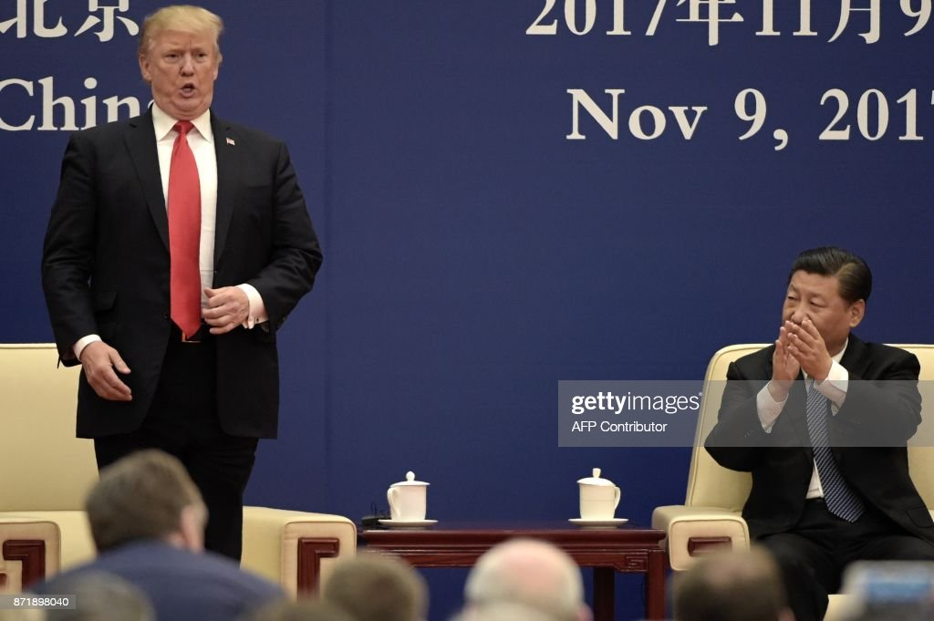 President Donald Trump speaks during a business meeting with Chinese President Xi Jinping at the Great Hall of the People in Beijing on November 9, 2017. Donald Trump and Xi Jinping put their professed friendship to the test on November 9 as the least popular US president in decades and the newly empowered Chinese leader met for tough talks on trade and North Korea. /